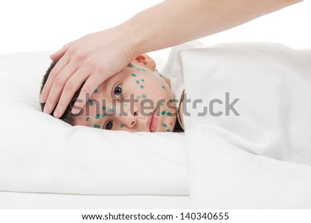 Mom touching sick boy his forehead - stock photo