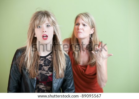Mom upset over daughter's inappropriate clothing - stock photo