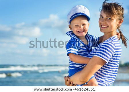 Mom with a child on the beach