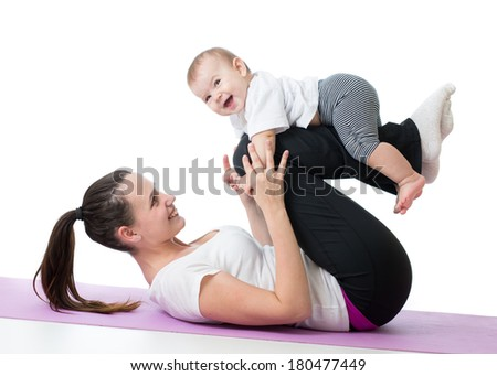 mom with baby doing gymnastics and fitness exercises - stock photo