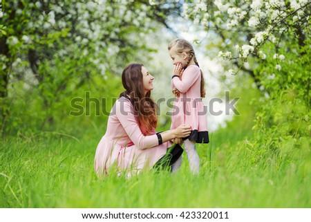 Mom with baby garden - stock photo