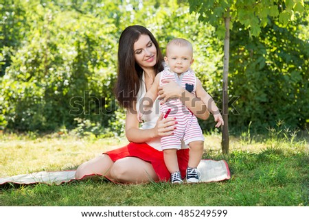 mom with baby in park