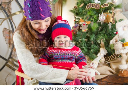 Mom with baby near Christmas tree