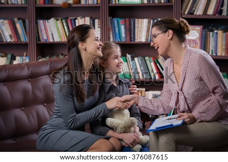 Mom with daugher on consultation - stock photo