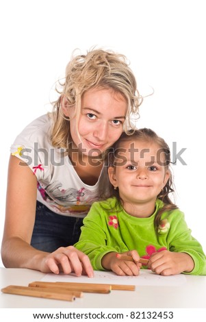 mom with her child drawing at table