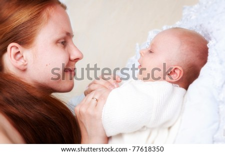 mom with her daughter laying on the bed - stock photo