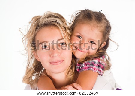 mom with her daughter on a white