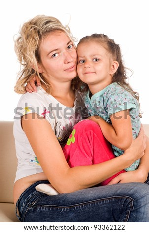 mom with her daughter on a white - stock photo