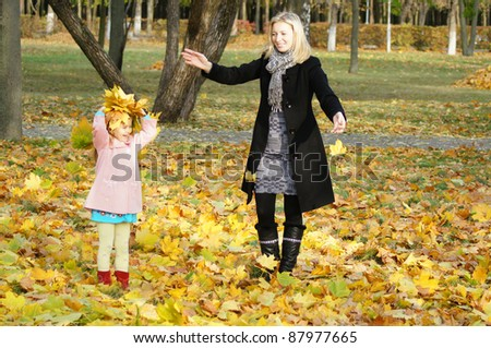 mom with her daughter playing at park - stock photo
