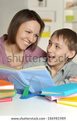 Mom with her son doing homework at home
