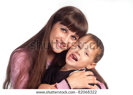 mom with her son posing on white