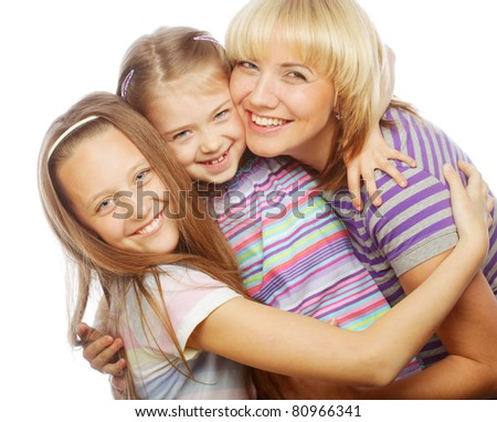 mom with two sisters. happy family. - stock photo