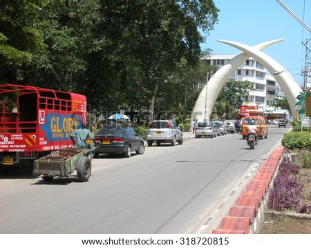 "MOMBASA, KENYA - November 22, 2007: Moi Avenue in Mombasa with the Mombasa ""Tusks"" portal. The memorial was built to commemorate the visit of Queen Elizabeth to Mombasa in 1952. - stock photo"