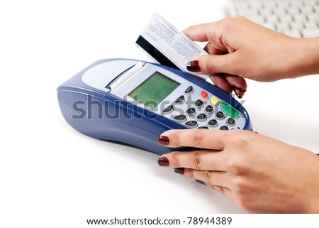 Moment of payment with credit card through terminal - stock photo