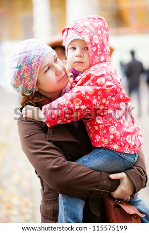 Moment of tenderness. Young mother and her beautiful daughter