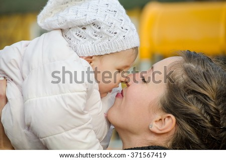 mommy and baby noses touching outdoor