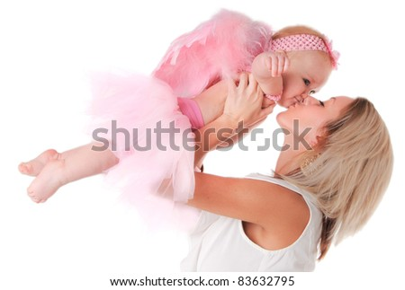 Mommy holding and kissing her baby girl dressed as an Angel - stock photo