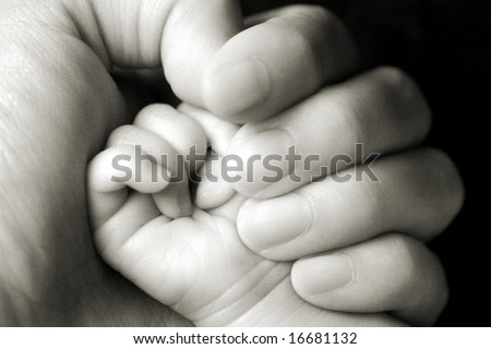 mommy holding baby's hand - stock photo