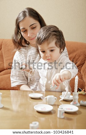 Mommy playing with daughter at table