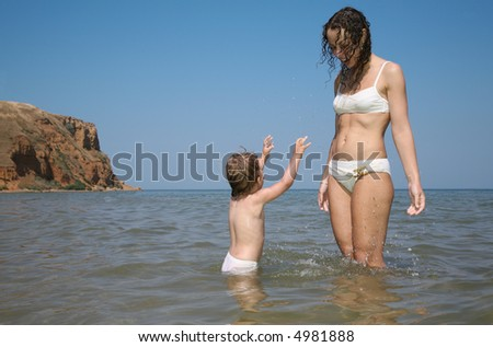 Mommy with daughter in sea