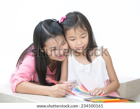 Mon and girl drawing a home work  - stock photo