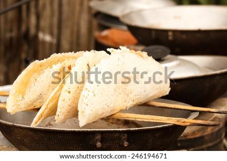 Mon crispy pancake in process, Thailand - stock photo