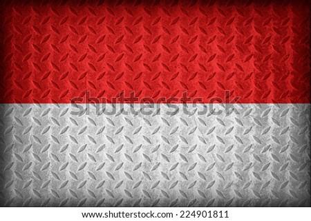 Monaco flag pattern on the diamond metal plate texture ,vintage style - stock photo