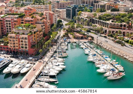 Monaco harbor with yachts and motor boats - stock photo