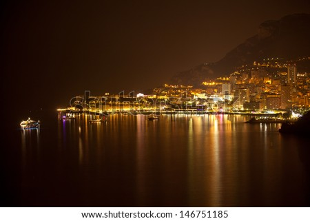 Monaco, Monte Carlo by night with reflection - stock photo