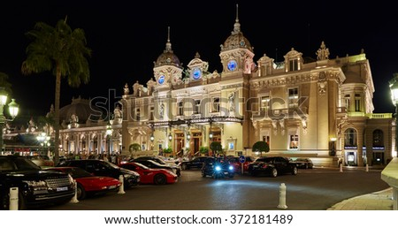 Monaco, Monte-Carlo, 04.09.2015: Casino Monte-Carlo in the night, hotel de Paris, night illumination, luxury cars, players, tourists, fountain, cafe de paris, long exposure, summer