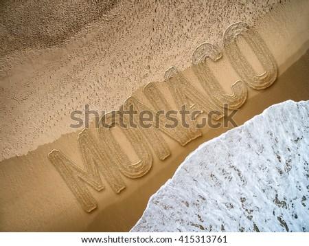 Monaco written on the beach - stock photo
