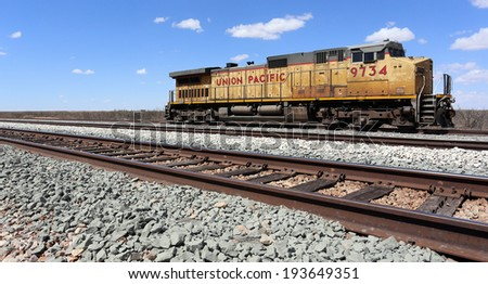 MONAHANS, TX � MARCH 15: A Union Pacific diesel locomotive sits idle in Monahans, Texas on March 15, 2014. The Union Pacific Railroad is an American freight railroad company headquartered in Nebraska. - stock photo