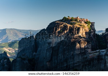 monasteries of Meteora valley in sunrise - stock photo