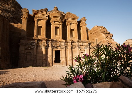 Monastery at Petra in Jordan,  with nice frontground element. - stock photo