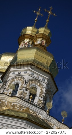 Monastery cupolas at Kiev Pechersk Lavra on blue sky background - stock photo