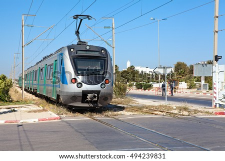 MONASTIR, TUNISIA, AFRICA - CIRCA NOV, 2012: Intercity passenger electric speed train is in Monastir airport station in Tunisia suburbans