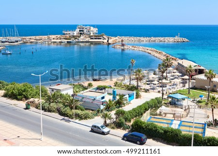 MONASTIR, TUNISIA - CIRCA MAY, 2012: Coastline and embankment are in the city of Monastir, the Mediterranean Sea. Aerial view at the Dimmas bay