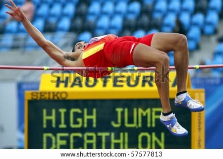 MONCTON, CANADA - JULY 20: Jonay Jordan of Spain (ESP) performs the high jump as part of the decathlon during the 2010 IAAF World Junior Championships on July 20, 2010 in Moncton, Canada. - stock photo