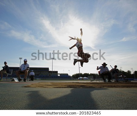 MONCTON, CANADA - June 28: Divyajyoti Biswal competes in the women's long jump at the Canadian Track & Field Championships June 28, 2014 in Moncton, Canada. - stock photo