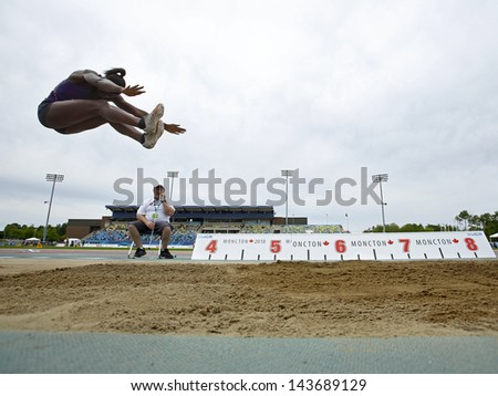 MONCTON, CANADA - June 22: Heptathlon long jumper Tamara Cap is airborne at the Canadian Track & Field Championships June 22, 2013 in Moncton, Canada. - stock photo