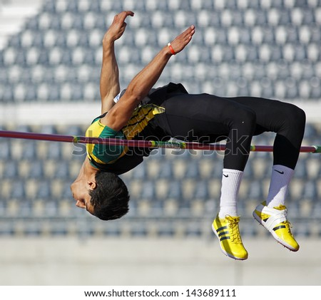 MONCTON, CANADA - June 22: High jumper Ali er-Rahab competes at the Canadian Track & Field Championships June 22, 2013 in Moncton, Canada. - stock photo