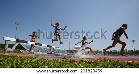 MONCTON, CANADA - June 28: Katie Robinson, Alycia Butterworth, Julie-Anne Staehli and Maria Bernard in the steeplechase at the Canadian Track & Field Championships June 28, 2014 in Moncton, Canada. - stock photo