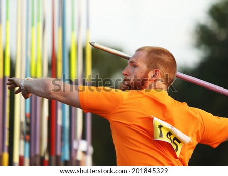 MONCTON, CANADA - June 28: Kyle Nielsen aims the javelin at the Canadian Track & Field Championships June 28, 2014 in Moncton, Canada. - stock photo