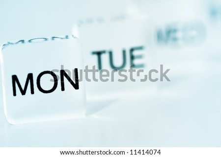 Monday Blues. Mood shot of calendar days plastic blocks - intentional selective focus. - stock photo