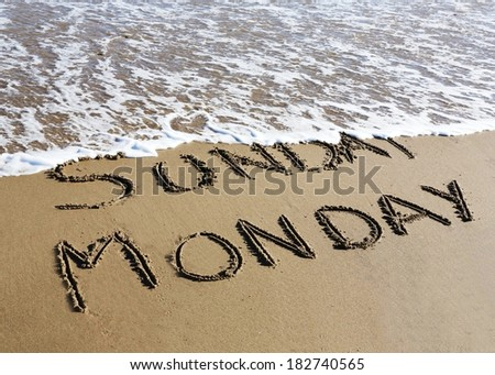 Monday is coming concept - inscription Sunday and Monday written on a sandy beach, the wave is starting to cover the word Sunday.  - stock photo
