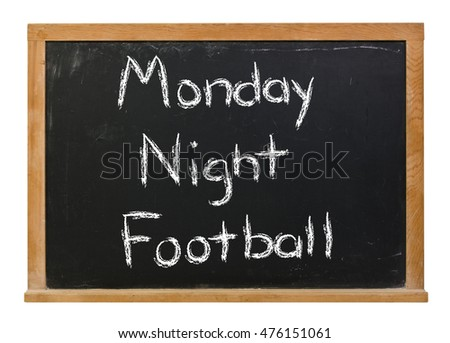 Monday Night Football written in white chalk on a black chalkboard isolated on white