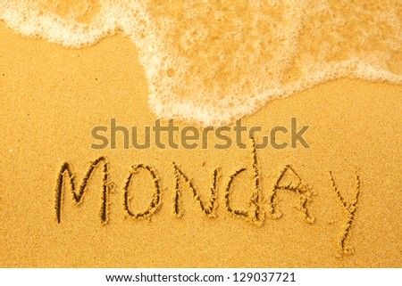Monday - written in sand on beach texture - soft wave of the sea (days week series) - stock photo