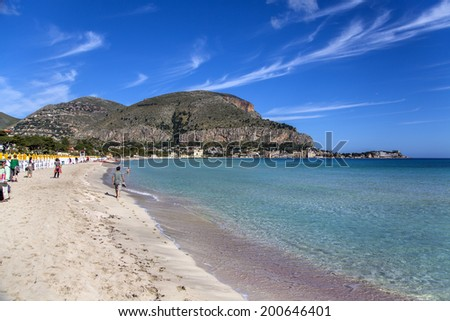 MONDELLO, ITALY - MAY 1, 2014: Unidentified people at the beach of Mondello at Sicily.  At the end of the 19th century Mondello grew into a favourite tourist destination - stock photo