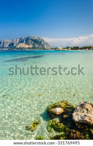 MONDELLO, SICILY, ITALY - MAY 26; clear turquoise waters of Mondello beach on May 26, 2011. - stock photo