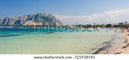 MONDELLO, SICILY, ITALY - MAY 26; clear turquoise waters of Mondello beach with bathing people, on May 26, 2011. - stock photo